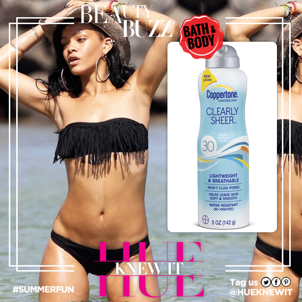 Rihanna uses sunscreen at the beach this summer